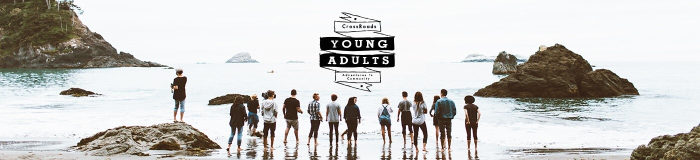 young adults in front of ocean